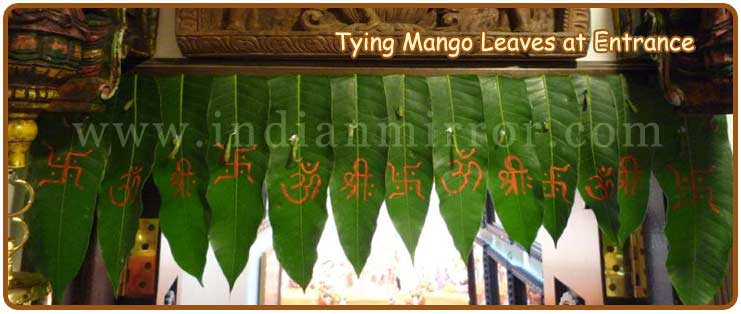Tying Mango Leaves At The Entrance